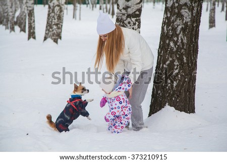 beautiful mother and daughter and dog in winter