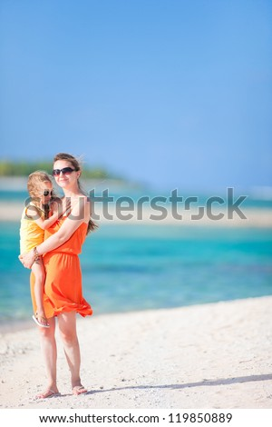 Beautiful mother and daughter on a tropical vacation - stock photo