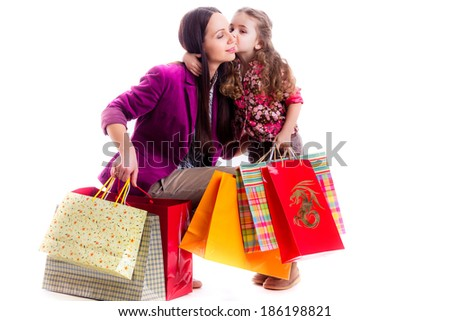 beautiful mother and daughter with shopping bags, isolated on white background - stock photo