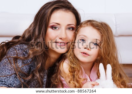 Beautiful mother and little daughter - stock photo