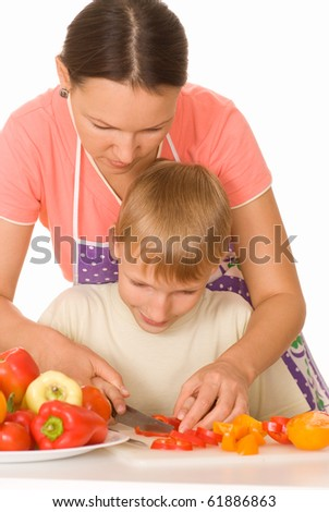 beautiful mother and son prepares breakfast vegetable