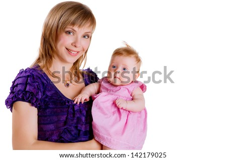 Beautiful mother raising her daughter looking with tenderness isolated on a white background