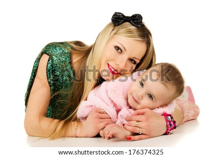 Beautiful mother with baby cuddling - stock photo