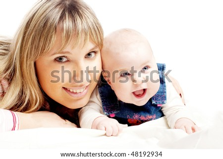 beautiful mother with cute baby daughter
