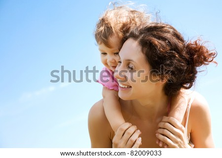 Beautiful mother with cute young girl have good summertime - stock photo