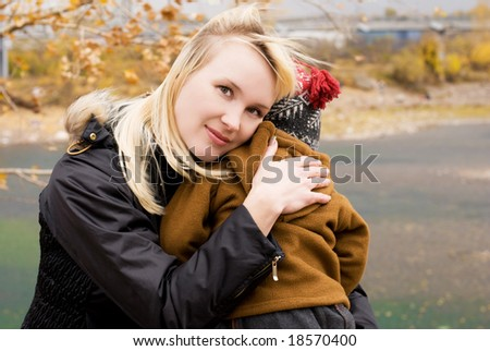 beautiful mother with her little son outdoor