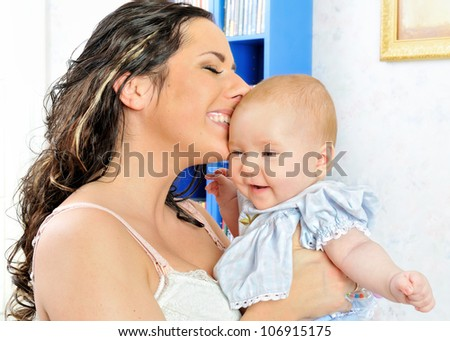 Beautiful mother with her newborn baby. - stock photo