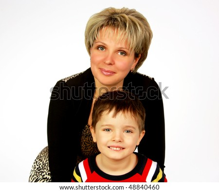 beautiful mother with her son posing in studio