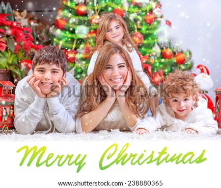 Beautiful mother with three cheerful kids near Xmas tree at home, celebrating Christmas, festive greeting card, happy family holiday concept