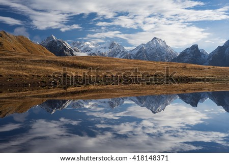Beautiful mountain lake. Reflection of clouds in water. Lake Koruldi. Caucasus, Georgia, Zemo Svaneti - stock photo