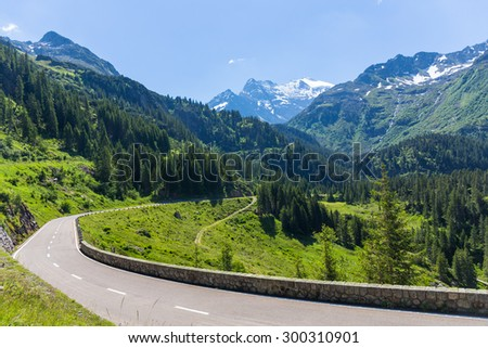 Beautiful mountain landscape, alpine road through pass, Switzerland - stock photo