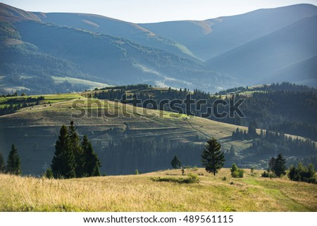 Beautiful mountain landscape and slope illuminated by the sun