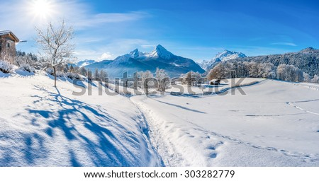 Beautiful mountain landscape in the Bavarian Alps with a snowy path down to the village of Berchtesgaden and famous Watzmann massif on a sunny day, Nationalpark Berchtesgadener Land, Bavaria, Germany