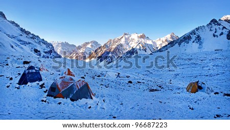 Beautiful mountain landscape in the Himalayas with high camp at sunrise - stock photo