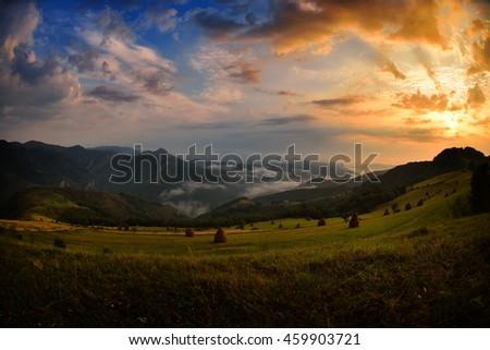 beautiful mountain landscape on foggy morning in Dumesti, Alba county, Romania - stock photo