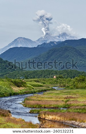 Beautiful mountain landscape: view of eruption active Zhupanovsky Volcano on Kamchatka Peninsula (Russia, Far East). - stock photo