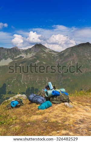 Beautiful mountain landscape with backpacks