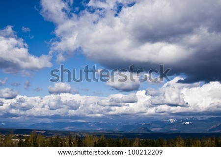 Beautiful  mountain landscape with blue sky and clouds - stock photo