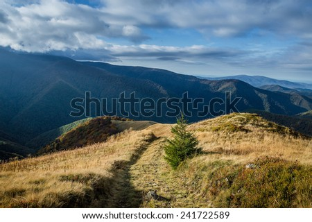 Beautiful mountain landscape with clouds - stock photo