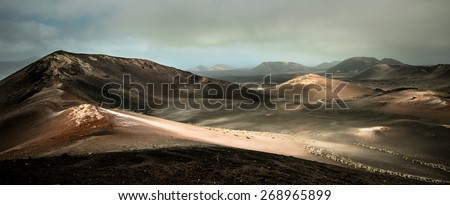 beautiful mountain landscape with volcanoes in Timanfaya National Park in Lanzarote, Canary Islands - stock photo
