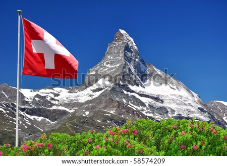 Beautiful mountain Matterhorn with Swiss flag - Swiss Alps - stock photo