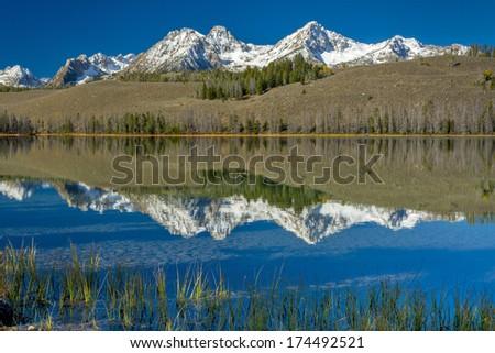 Beautiful mountain range and lake with reflections - stock photo