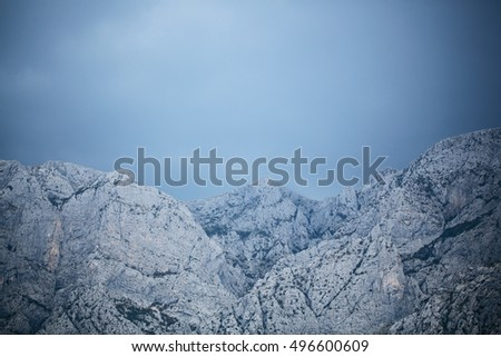 Beautiful mountain ranges with high peaks natural elevation of earth surface on blue sky background