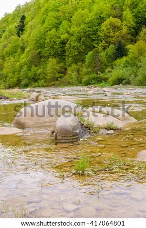 Beautiful mountain river, a magnificent landscape - stock photo