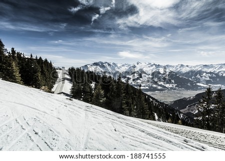 Beautiful mountain ski slope with with Kitzsteinhorn in the background (Alps in Austria) - stock photo