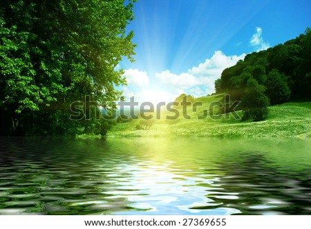 beautiful mountain valley reflection on river surface - stock photo