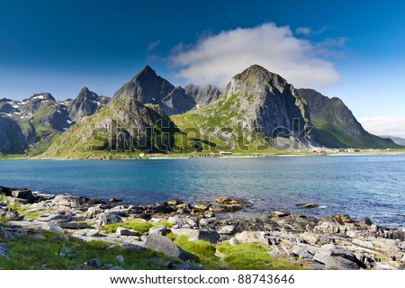 beautiful mountainous landscape around Norwegian fjord in sunny day - stock photo