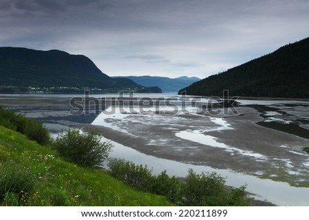 Beautiful  mountainous landscape with coastline and fishing villages in Newfoundland, Canada - stock photo