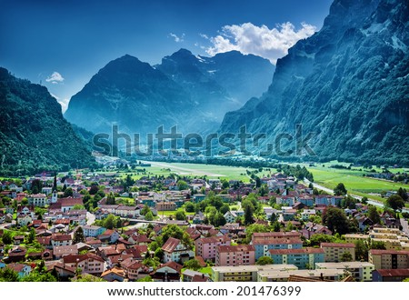 Beautiful mountainous village, many little buildings in European mountain city, luxury resort, active travel and vacation concept - stock photo