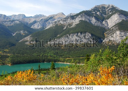 Beautiful mountains and alpine lake in fall in kananaskis country, alberta, canada - stock photo