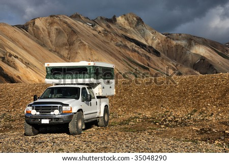 Beautiful mountains in Iceland. Famous volcanic area with rhyolite rocks - Landmannalaugar. Off-road recreational vehicle. Camper jeep. - stock photo