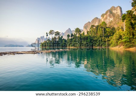Beautiful mountains lake river sky and natural attractions in Ratchaprapha Dam at Khao Sok National Park, Surat Thani Province, Thailand. - stock photo