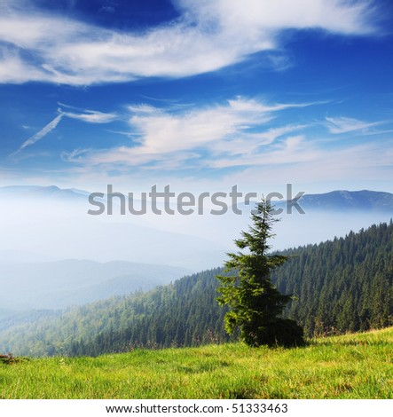 Beautiful mountains landscape and cloudy sky - stock photo