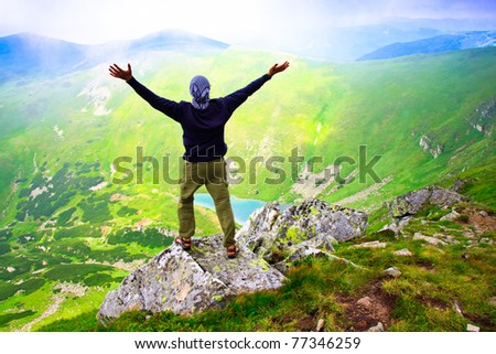 Beautiful mountains landscape with lake  in Carpathian mountains and man - stock photo