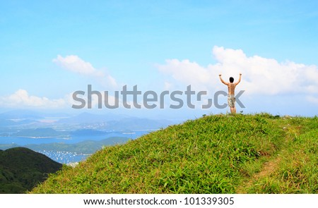 Beautiful mountains landscape with lake in hongkong and man on the top - stock photo