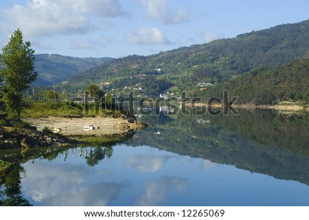 beautiful mountains reflected in the river of crystal clear water... - stock photo