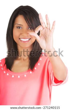 Beautiful mulato woman gesturing ok - stock photo
