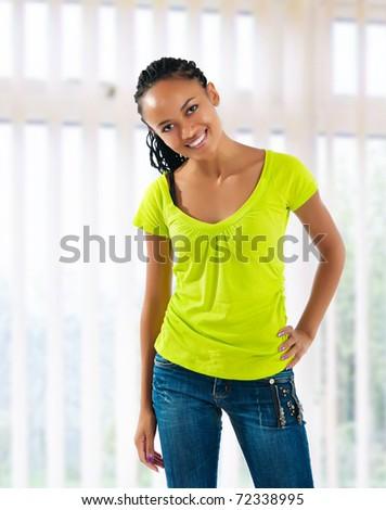 beautiful mulatto girl on window  background - stock photo