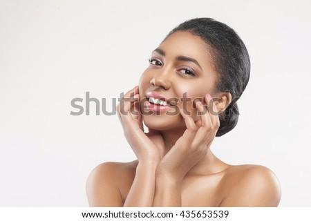 Beautiful mulatto girl prefers skincare treatment - stock photo