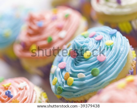 beautiful multi colored cupcake with shallow depth of field. Sweet dessert for a birthday. - stock photo