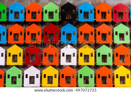 Beautiful multi colored model of house depicting a residential colony