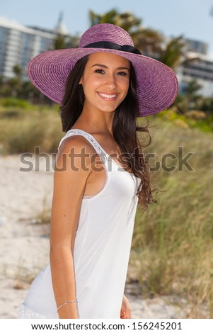 Beautiful multicultural young woman enjoying Miami Beach.