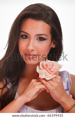 Beautiful multicultural young woman in a beauty studio portrait pose with a white background. - stock photo