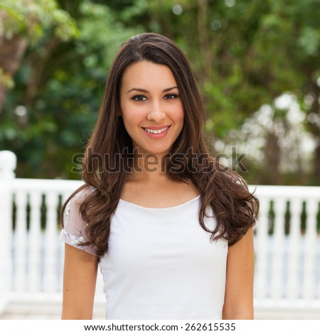 Beautiful multicultural young woman outdoor portrait. - stock photo