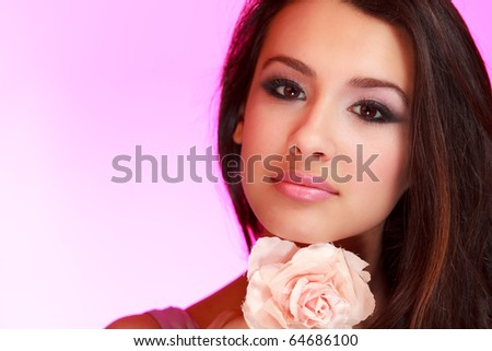Beautiful multiracial young woman in a fashion beauty pose with a lighted purple background. - stock photo