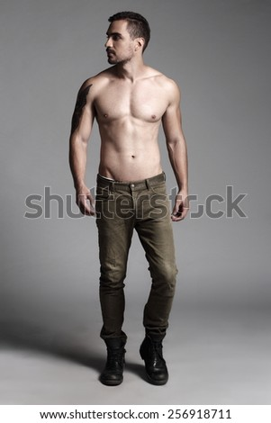 Beautiful muscular male model with nice abs in jeans  - stock photo